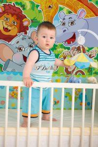 Baby on crib at home